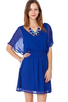 ShopSosie Style : Becca Flutter Dress. Chiffon dress featuring short dolman sleeves, cinched waist, and v neck and backline. Slit at back with button closure. Lined.