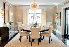 A neutral dining room with beautiful lighting
