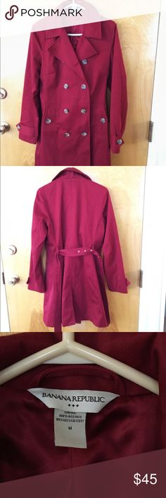 Banana republic double breasted trench coat Beautiful rich ruby red trench coat with a belt and double breasted buttons.  Gives a very nice tailored cinch at the waist look.    Will look amazing for work or play.   Size med Banana Republic Jackets & Coats Trench Coats