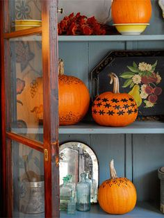 Pumpkins on Display: Add petite pumpkins to an existing display to dress it up for fall. Plain pumpkins work well, but if you want to add some extra flair, paint designs on the pumpkins in colors that match your decor.