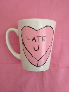 white porcelain mug with hand painted 'hate u' sweetheart in light pink and black. $6