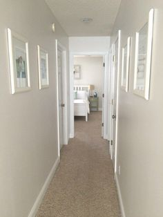 Painting trim is a great way to update a dark hallway. Love these tips! & Five Ways To Update And Brighten A Dark Hallway | DIY Home Decor ...