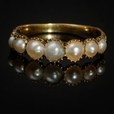 Seven natural pearls in yellow gold ring. Lovely detailed engraving on the band. Circa 1820 (Georgian), England.