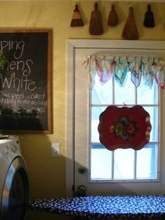 cute idea to put the old hand brooms above the window.. love it