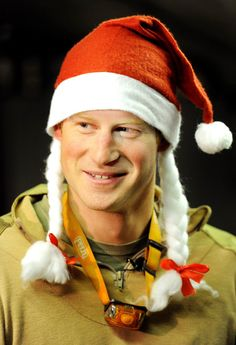 """Prince Harry Heads Home From War and Talks Nude Photos —""""I Let My Family Down"""": Prince Harry wore a Santa hat around the base in December."""