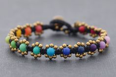 I'd do this with turquoise centers and sterling beads...............Rainbow Stone Kim wax, ray knot knitting bracelet