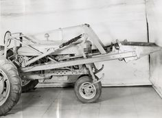 Farmall M Tractor with Mounted Power Loader | Photograph | Wisconsin Historical Society