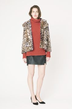 Gisele fake fur jacket with rollneck knit & leather skirt from Ganni 2015 Pre Spring collection.