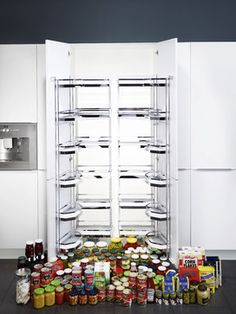 """Tandem Pantry The Tandem pantry can be used in cabinets from 30""""-42"""" wide in the dual configuration. When the door is opened, the shelves in the back are pulled forward for easy access. Specifications      Sold By     Clever Storage by Kesseböhmer 