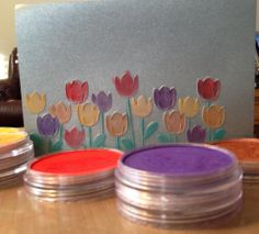 Embossed blueish/grey metallic paper with soft gold, red, purple and copper Pan Pastels.