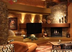 Dramatic, rustic style custom media wall with natural stone accents, custom lighting design, floating LCD TV and fireplace design and custom-built by DAGR Design