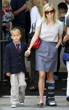 #ReeseWitherspoon sporting a bare walking boot.
