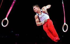 Team USA's Jonathan Horton dismounts this still rings during men's Olympics gymnastics team finals in London.