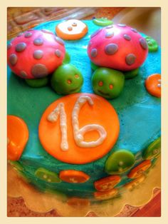 Birthday cake with fondant turtles and buttons on buttercream.
