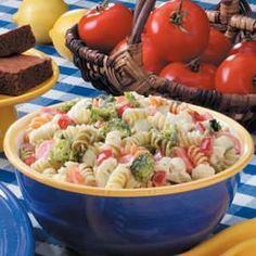 Pasta Vegetable Salad Recipe -It only takes minutes to cook the tricolor pasta, but to really beat the clock, chop the vegetables ahead of time. I sometimes give the salad southwestern flair by adding black beans, frozen corn and salsa. The I top it off with a tomato-based dressing that I've spiced up with taco seasoning.—Helen Turner, Upland, Indiana