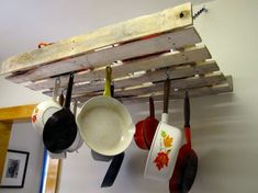 """3. Pot Rack  Isn't this clever? Basically, you add chicken wire to the """"interior"""" of the pallet and then hang it in your kitchen. Again, if you want …"""