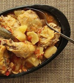 Colombian Chicken Stew with Potatoes, Tomato, and Onion - Full recipe here... http://www.seriouseats.com/recipes/2012/05/colombian-chicken-stew-with-potatoes-tomato-onion-recipe.html