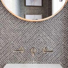 Black, white, and brass in this pretty wallpapered powder room. Elizabeth Lawson Design