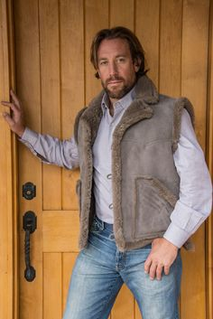 Custom sheepskin vests for men made by hand at The Sheepherder. In gold, it's pretty cool, but the roll at the shoulder and the bottom is too much.
