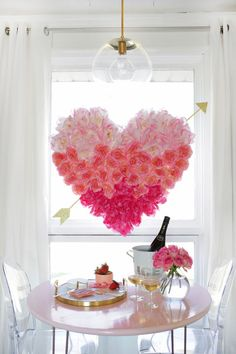 HANGING HEART FLORAL:The only thing more beautiful than crisp morning light spilling through a window is crisp morning light illuminating this stunning floral heart hanging. The best part? This DIY uses fake flowers, so you'll be able to display it every Valentine's Day. Click through for more Valentine's Day crafts.