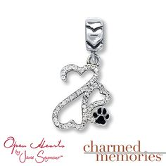 This Charmed Memories® charm is the perfect symbol of love for a pet. Featuring an Open Hearts Family by Jane Seymour™ design accompanied by a paw print, the charm is crafted of sterling silver and decorated with black enamel and clear SWAROVSKI ELEMENTS.