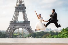 Happy rapper couple celebrating their wedding in Paris. Jumping in front of the Eiffel Tower. Picture captured by Paris wedding photographer Fran Boloni