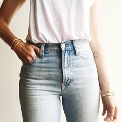 Denim Jeans with White T-Shirt Tucked in.