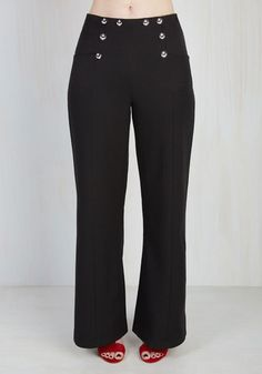 Rule the conference room like a captain on the high seas in these nautical black trousers! Stylishly decorated with anchor-bedecked buttons and accent seams down each wide leg, these high-waisted pants fuse with your confidence to highlight your professional prowess.