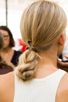 Stuck in a hair rut? Try this quick and easy wrap around braid/bun hybrid. It takes seconds but looks totally cool.