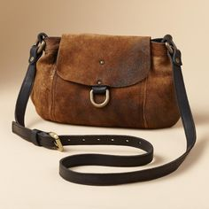 """LARCHMONT HANDBAG--Distressed Italian lambskin lends antique allure to this compact bag with magnetic snap flap and rear slip pocket. Contrast strap adjusts for shoulder or crossbody wear. Leather-lined, two open pockets. Each is one of a kind. Made in USA. 10""""W x 3""""D x 7""""H."""