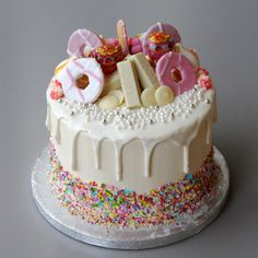 A white chocolate drip cake for all the lovers of sweets out there! With all the favourites; from party rings to white chocolate kitkats and chupa chups! 18th Birthday Cake For Girls, Sweet Birthday Cake, Birthday Drip Cake, Birthday Cake Decorating, Girly Birthday Cakes, Chocolate Birthday Cake Kids, Chocolate Finger Cake, Best Chocolate Cake, White Chocolate