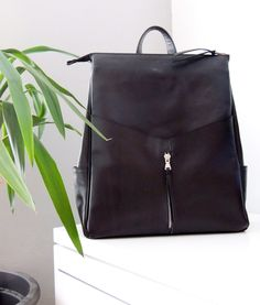 d2d5f1a735 Backpack in black leather. • topchii • Tictail