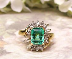 Hey, I found this really awesome Etsy listing at https://www.etsy.com/listing/224183125/vintage-emerald-engagement-ring-145ct
