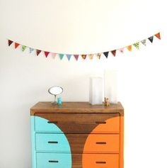 Love the look of a partially painted dresser- neatly done so parts of wood grain are left naked!