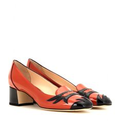 Bottega Veneta - Patent leather pumps - These Bottega Veneta pumps feature wonderful retro details with a block heel and square-toe design. The orange patent leather is adorned with flame-like black detailing for added drama and flair. Wear with a knee-length skirt in a neutral shade so they can really stand out. seen @ www.mytheresa.com
