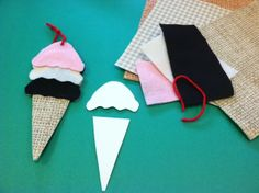 """A sweet ice cream bookmark! Make a three scoop template out of poster board, plus additional cone templates and scoop templates from poster board. Select materials that have different textures such as felt, foam, and textured wallpaper to be glued on to both sides of the bookmark. Children love selecting their own """"flavors"""" for this ice cream craft. #Greenwich Library #Children's #Crafts"""