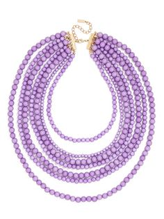 The motif of this necklace is easy enough—just simple shiny beads—but done up in a lush multi-strand look like this, the vibe is stunningly dramatic and extravagant. Color may rub off on clothing during wear, we recommend wearing this piece with dark colors.