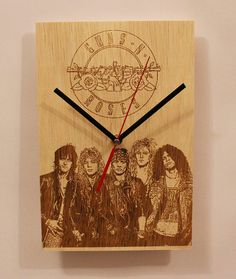 Check out this item in my Etsy shop https://www.etsy.com/listing/492238482/handmade-wooden-wall-clock-band-guns-n