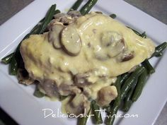Creamy mushroom chicken in the crock pot... wow!  Tried this tonight. It was delicious! But I can't help but think it could have benefitted from a bit of chicken stock to thin out the soup and cream cheese a little.