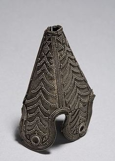 gorgeous metal top for viking cone hat, from Birka. At Historiska museet