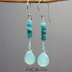 Handmade earrings featuring gorgeous neon blue Apatite beads and Aqua Chalcedony faceted pear briolettes. Simply stunning! They are the perfect earring for Summer! The ear wires and all findings are s