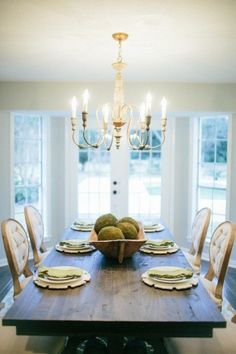 The Unstately Manor || Every dining table deserves great light fixtures. This beautiful chandelier brings a subtle elegance to this dining room. #joannagaines #fixerupper #magnoliahomes #magnolia
