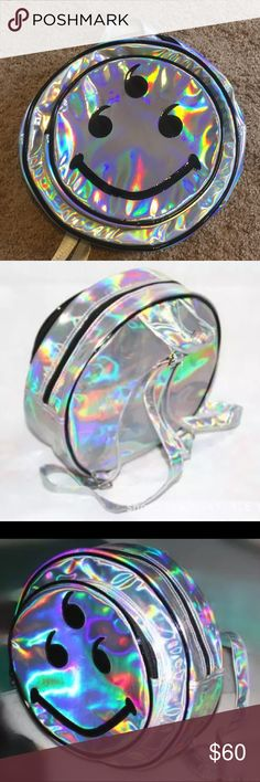 Alien backpack third eye holographic bag purse edc Awesome hologram backpack! Great for music festivals concerts raves Coachella burning man etc. NO BRAND. PRICE FIRM New backpack unused. Holographic pvc type material, alien smilie face emoji with third eye. Tags: unif tote purse bag knapsack fanny pack festival style wear rave edc edm Kylie nasty gal wild fox dollskill disco sparkle sparkly little black diamond ocean moon iron fist iheartraves punk  goth hot topic demonia yru lip service…