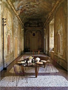 After standing empty for at least 50 years Giorgio Armani used this 17th-century apartment as a showroom. While renovating he stripped the apartment's floors & walls to surprisingly find bright marble Venetian terrazzo and colourful frescoes covered up with paint