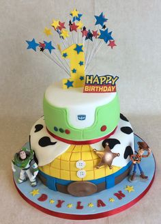 2 tier Toy Story themed 1st Birthday cake with Buzz and Woody characters