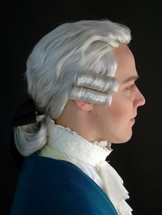 Man's wig. 18th Century.  This wig I can respect.  The color is not too artificially white.  The Stocks (neckband) have some issues.  They flare open and in contemporary portraits, I never see that. The flaring makes it more comfortable for the modern man, but in the 18th century, proper decorum was far more important than comfort.  It really was not how you feel, but how you look.