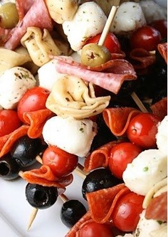 "ANTIPASTI KEBOBS: Antipasti means ""before the meal"" and is the traditional first course of a formal Italian meal. Traditional antipasto includes cured meats, olives, peperoncini, mushrooms, anchovies, artichoke hearts, various cheeses, pickled meats and vegetables (both in oil or in vinegar)."