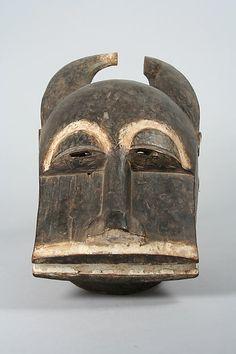 Buffalo Mask (Mblo) - Date: 19th–20th century Geography: Côte d'Ivoire, central Côte d'Ivoire Culture: Baule peoples Medium: Wood, kaolin, fiber