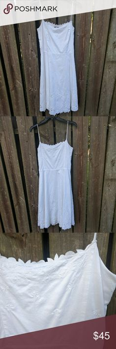 Anne Taylor White Flower Cut-Out Dress Really pretty white dress. Only worn once. It looks brand new. Features hidden side zipper, pretty square neckline with cutout flower details at the top and at the bottom of the skirt. The skirt is lined.   The tag says it's a size six, but i had it fitted a bit, so it will fit like a size 4. So I'm listing it as a 4. Ann Taylor Dresses Midi