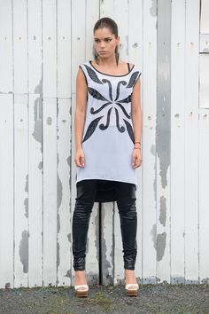 Stylish and easy to wear tunic, suitable for every occasion. Handmade pattern of eco(artificial) leather at the front of the tunic. The back is entirely black, draped and falls freely. Looks great with leggings, long pants and jeans.